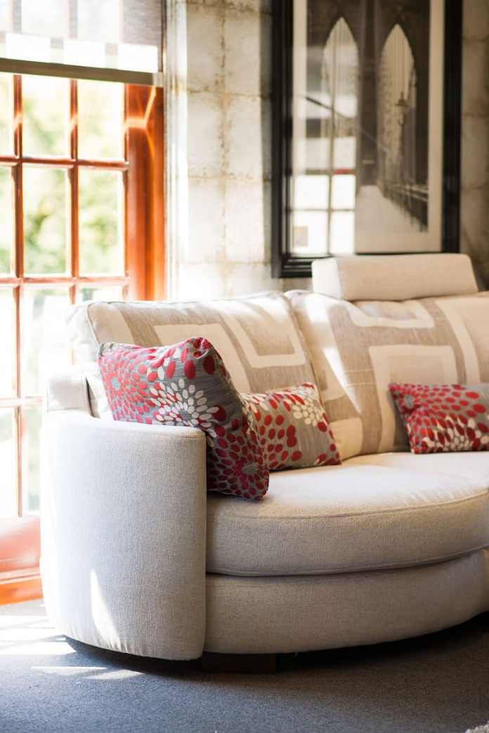 Fama Sofa Range in Light Colours With Red Floral Patterned Scatter Cushions